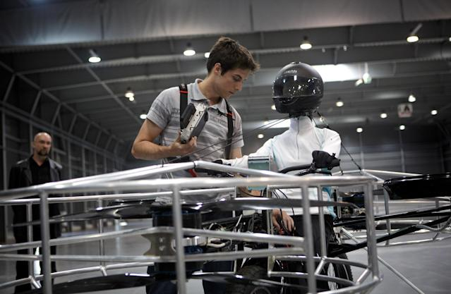 A technician prepares a 'Flying bike' bicycle ahead of its first public flight on June 12, 2013 in Prague, Czech Republic. The bike has been manufactured by 3 different companies from the Czech Republic (Duratec, Technodat, Evektor) and has been supported by French Company Dassault System. The F-Bike has four main motors (10kW) and two stabilization motors (3,5 kW). It has an estimated constant flight time of 3-5 minutes. (Photo by Matej Divizna/Getty Images)