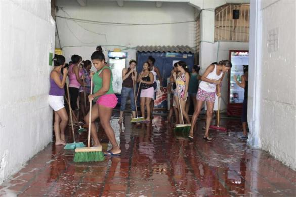 Inmates wash the floor in Cartagena's Women's District Jail March 6, 2012.