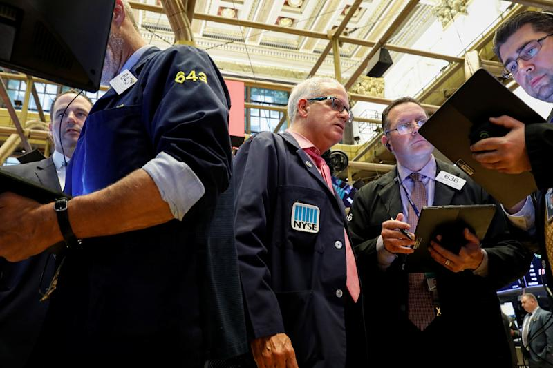 Traders work on the floor at the New York Stock Exchange (NYSE) in New York, U.S., October 30, 2019. REUTERS/Brendan McDermid