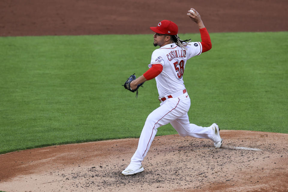 Cincinnati Reds' Luis Castillo throws during the third inning of a baseball game against the San Francisco Giants in Cincinnati, Tuesday, May 18, 2021. (AP Photo/Aaron Doster)