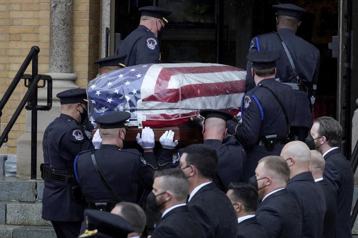 """Pallbearers from the U.S. Capitol Police carry the casket of William """"Billy"""" Evans into St. Stanislaus Kostka Church before a funeral Mass, Thursday, April 15, 2021, in Adams, Mass. Evans, a member of the U.S. Capitol Police, was killed on Friday, April 2, when a driver slammed his car into a checkpoint he was guarding at the Capitol. (AP Photo/Steven Senne)"""