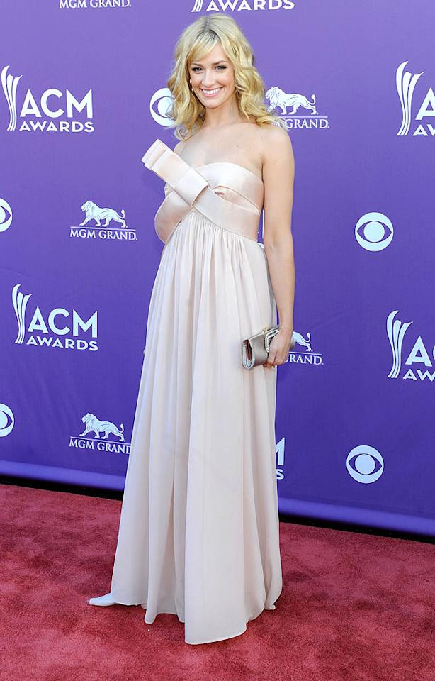 "<p class=""MsoNoSpacing"">Beth Behrs must have fancied herself a gift to the red carpet at the Academy of Country Music Awards because the ""2 Broke Girls"" star donned a dress adorned with a ridiculously giant bow – and one that looked like it wasn't properly tied to begin with. (4/1/2012)</p>"