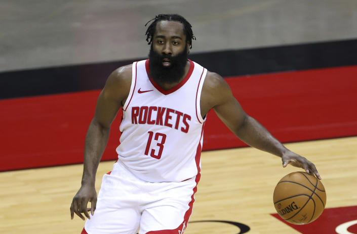 Houston Rockets' James Harden controls the ball during the first half of an NBA basketball game against the San Antonio Spurs in Houston, Thursday, Dec. 17, 2020. (Carmen Mandato/Pool Photo via AP)