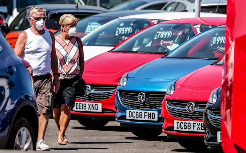 Potential car buyers at Vauxhall Lookers in Speke, Liverpool this week