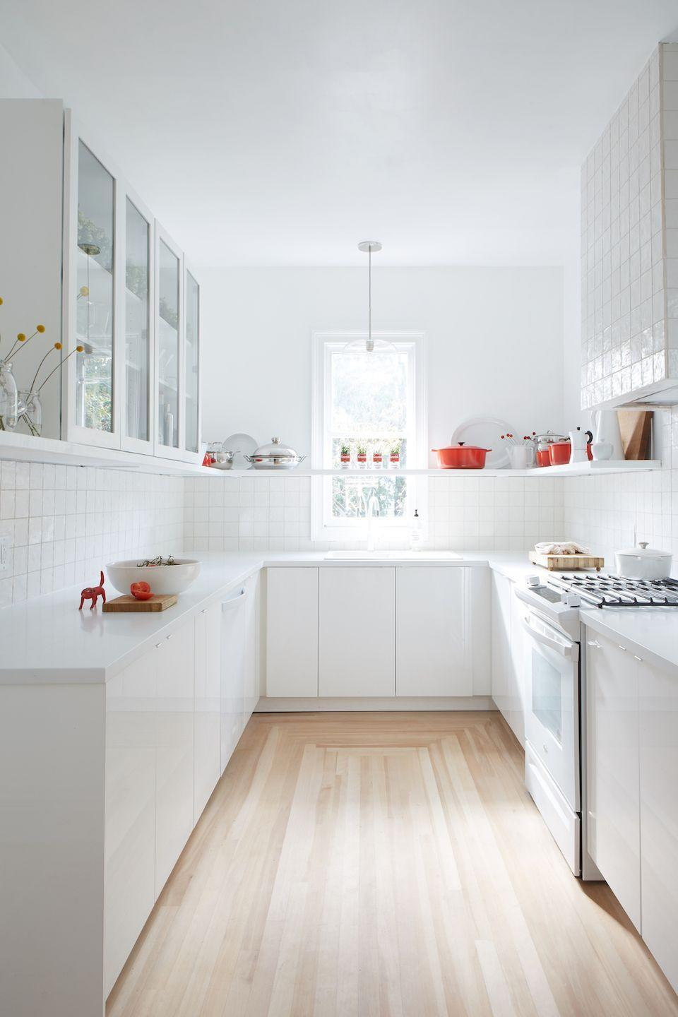 "<p>You can't go wrong with an all-white kitchen. This design trend, as mastered by Leanne ford here, is particularly well-suited for the room where cleanliness is essential. The pops of red cookware break thing up just enough, and we also love the <a href=""https://www.housebeautiful.com/design-inspiration/celebrity-homes/a26930340/leanne-ford-soup-can-planter/"" rel=""nofollow noopener"" target=""_blank"" data-ylk=""slk:upcycled soup cans"" class=""link rapid-noclick-resp"">upcycled soup cans </a>for an affordable decor solution channeling pop art. </p>"