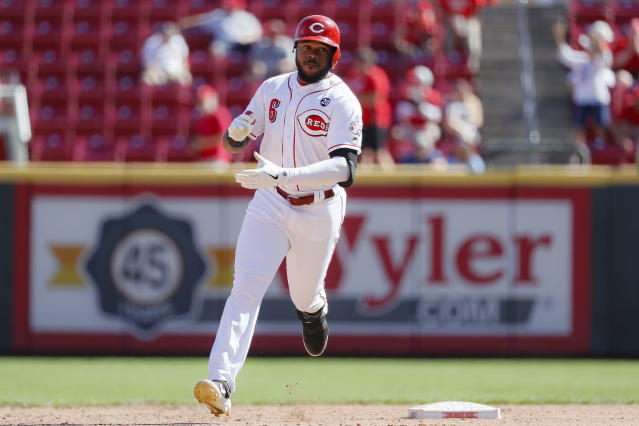 Cincinnati Reds' Phillip Ervin runs the bases after hitting a walkoff solo home run on Philadelphia Phillies relief pitcher Nick Vincent in the 11th inning of a baseball game, Thursday, Sept. 5, 2019, in Cincinnati. (AP Photo/John Minchillo)
