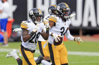 Pittsburgh Steelers safety Terrell Edmunds (34) celebrates with teammates cornerback Mike Hilton, left, and linebacker Marcus Allen, bak center, after intercepting a pass against the Jacksonville Jaguars during the first half of an NFL football game, Sunday, Nov. 22, 2020, in Jacksonville, Fla. (AP Photo/Matt Stamey)