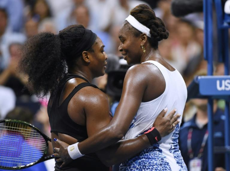 Family ties: Serena Williams hugs sister Venus after they met in the quarter-finals of the US Open in 2015