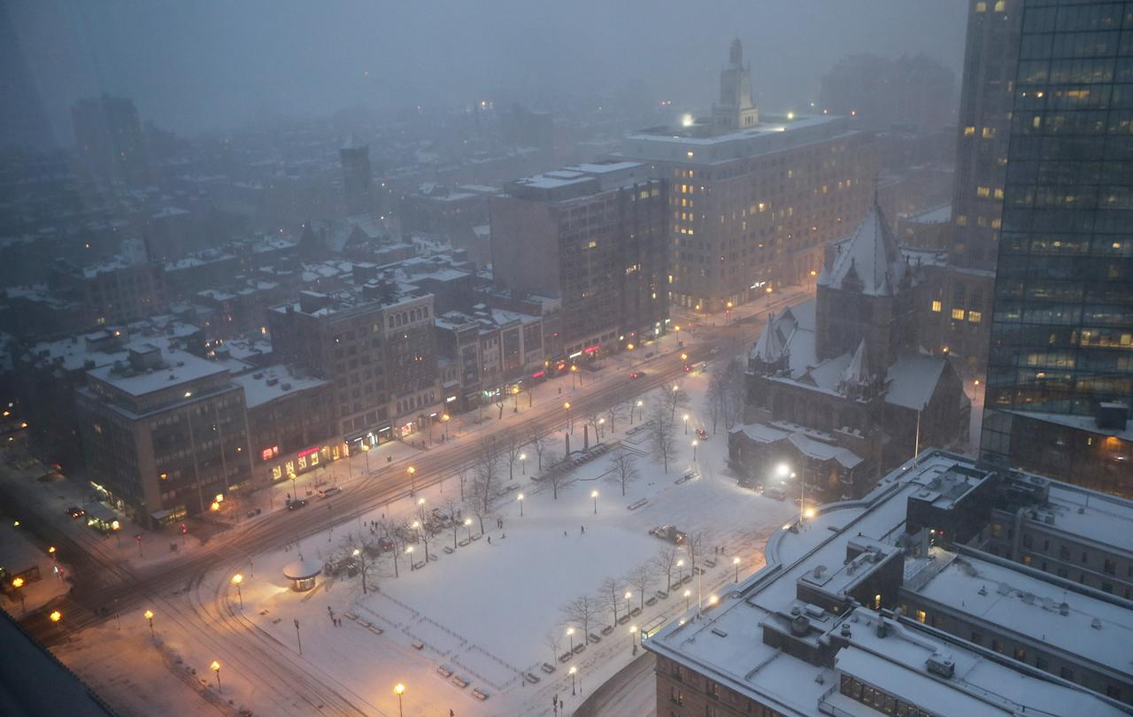 BOSTON, MA - FEBRUARY 08:  Snow falls on Copley Square on February 8, 2013 in Boston, Massachusetts. Massachusetts as well as other states from New York to Maine are preparing for a major blizzard with possible record amounts of snowfall in some areas.  (Photo by Mario Tama/Getty Images)