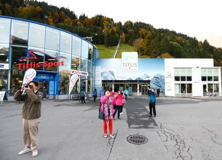 FILE PHOTO: Tourists take pictures in front of the lower terminus of the Titlisbahnen cablecar in Engelberg