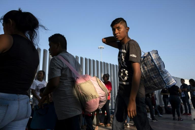 Asylum seekers gather at El Chaparral port of entry in Tijuana, Mexico as they seek an appointment to present their asylum request to US authorities