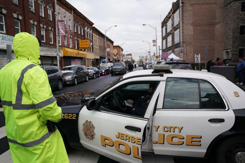 Jersey City police gather at the scene of Tuesday's shooting in Jersey City, New Jersey. (Photo: BRYAN R. SMITH via Getty Images)
