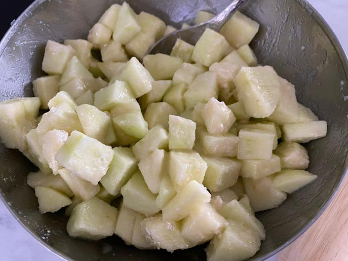 Chopped-up apples in a bowl.