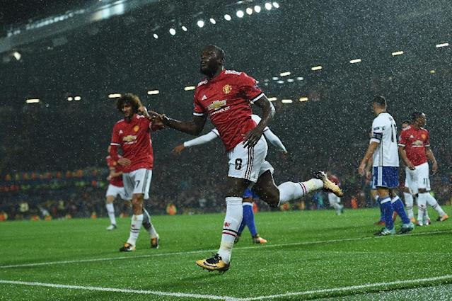 Manchester United's Romelu Lukaku celebrates scoring his team's second goal during their UEFA Champions League Group A match against Basel, at Old Trafford in Manchester, on September 12, 2017 (AFP Photo/Oli SCARFF )