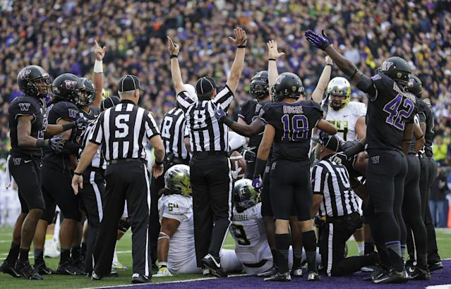 Officials signal a touchdown after Oregon running back Byron Marshall (9) scored a a a touchdown against Washington in the first half of an NCAA college football game, Saturday, Oct. 12, 2013, in Seattle. (AP Photo/Ted S. Warren)