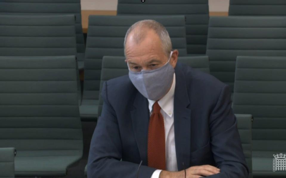 Sir Patrick Vallance appeared before MPs wearing a face mask back in July