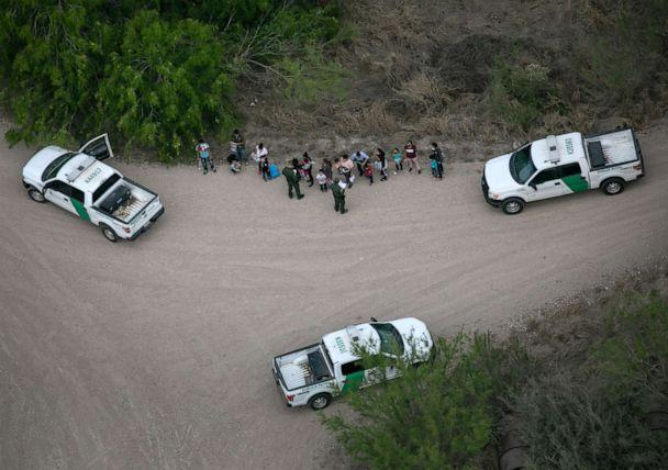 PHOTO: US Border Patrol agents take asylum seekers into custody near the US-Mexico Border on March 23, 2021, in McAllen, Texas. (John Moore/Getty Images)
