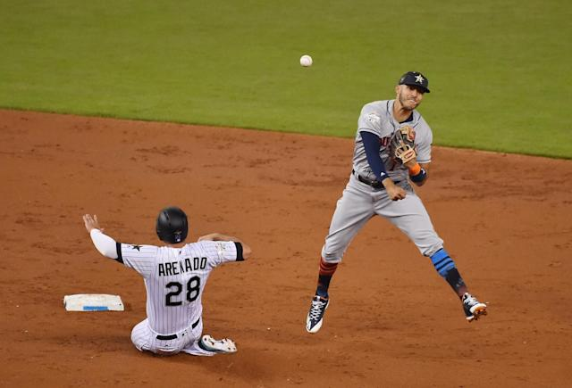 <p>American League infielder Carlos Correa (1) of the Houston Astros turns a double play over National League infielder Nolan Arenado (28) of the Colorado Rockies in the second inning during the 2017 MLB All-Star Game at Marlins Park. </p>
