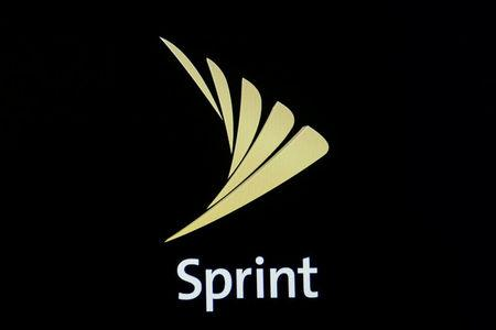 FILE PHOTO: The Sprint logo is displayed on a a screen on the floor of the New York Stock Exchange (NYSE) in New York City, U.S., April 30, 2018. REUTERS/Brendan McDermid