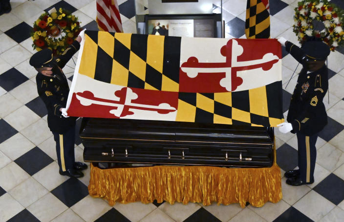 The Maryland National Guard Honor Guard drapes the Maryland flag on the casket of Maryland Senate President Emeritus Thomas V. Mike Miller under the dome of the State House in Annapolis, Md., Thursday, Jan. 21, 2021. (Kim Hairston/The Baltimore Sun via AP, Pool)