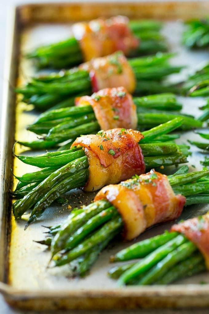 "<p>Sneak in vegetables and bacon all-in-one by making these tasty bundles. The are rich in flavor and have nutrients, too!</p> <p><strong>Get the recipe</strong>: <a href=""http://www.dinneratthezoo.com/green-bean-bundles/"" class=""link rapid-noclick-resp"" rel=""nofollow noopener"" target=""_blank"" data-ylk=""slk:bacon green bean bundles"">bacon green bean bundles</a></p>"