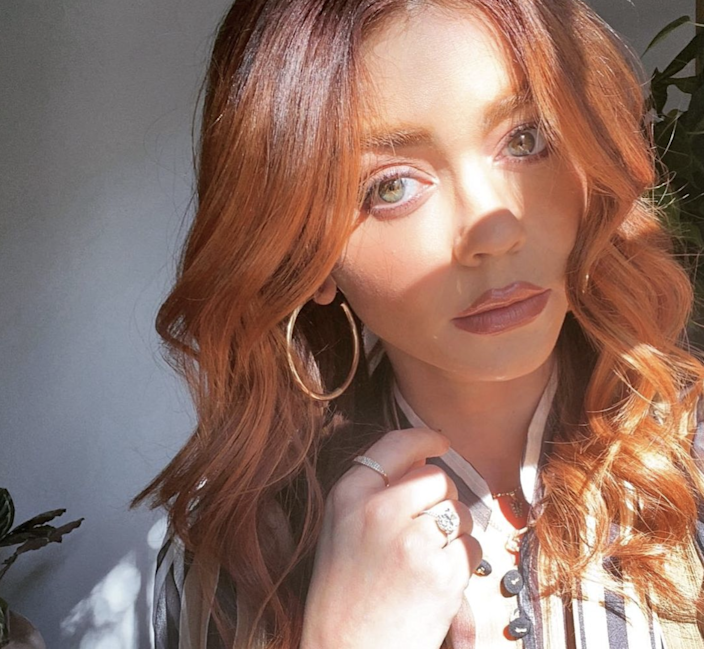 """Warm hues are having a huge moment this spring, and that means a broad spectrum of red shades are popping up everywhere — including on Sarah Hyland's head, where she recently went from brunette to coppery auburn. Colorist Nikki Lee <a href=""""https://www.allure.com/story/sarah-hyland-dyed-hair-color-red?mbid=synd_yahoo_rss"""" rel=""""nofollow noopener"""" target=""""_blank"""" data-ylk=""""slk:recently told Allure"""" class=""""link rapid-noclick-resp"""">recently told <em>Allure</em></a> that, while it's not always easy to bring brown hair to this perfect shade of rich, rusty red, the result is almost always flattering. """"I love a copper red as it is a change that can work on more people than you think,"""" she said."""