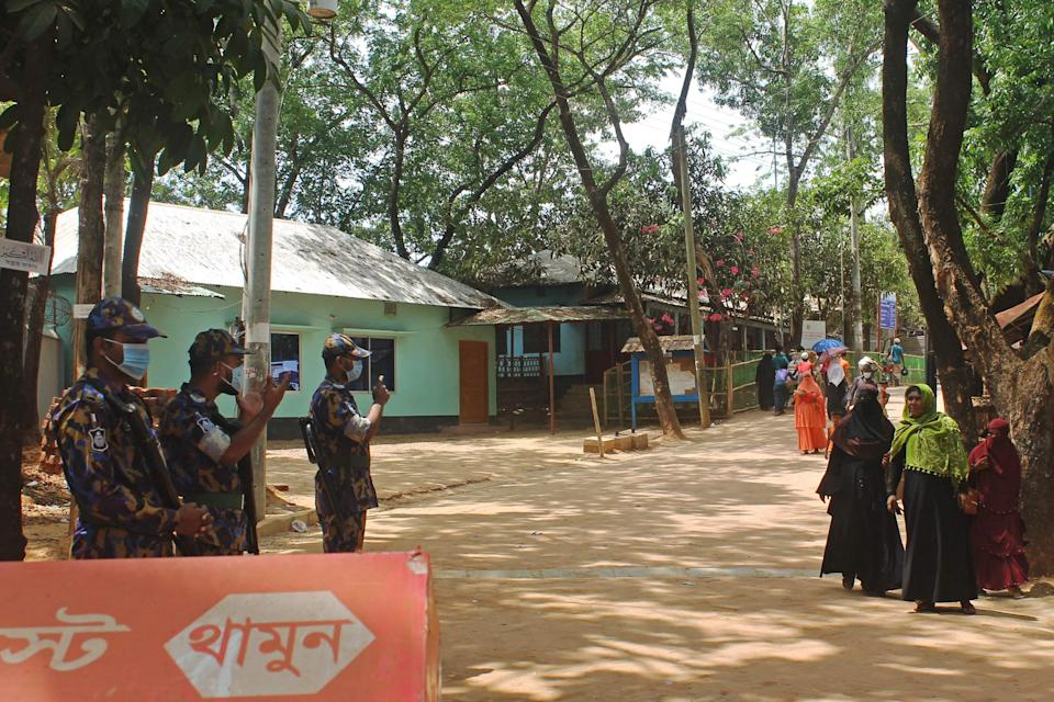 File image: Law enforcement personnel stand guard in the Kutupalong Rohingya refugee camp area where authorities imposed lockdown to contain the spread of the Covid-19 coronavirus in Ukhia (Bangladesh) on 21 May, 2021 (AFP via Getty Images)