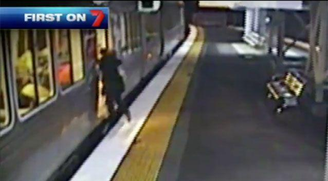 Rushing commuters: This one is a split second from stepping in the gap and falling into the train. Photo: 7 News
