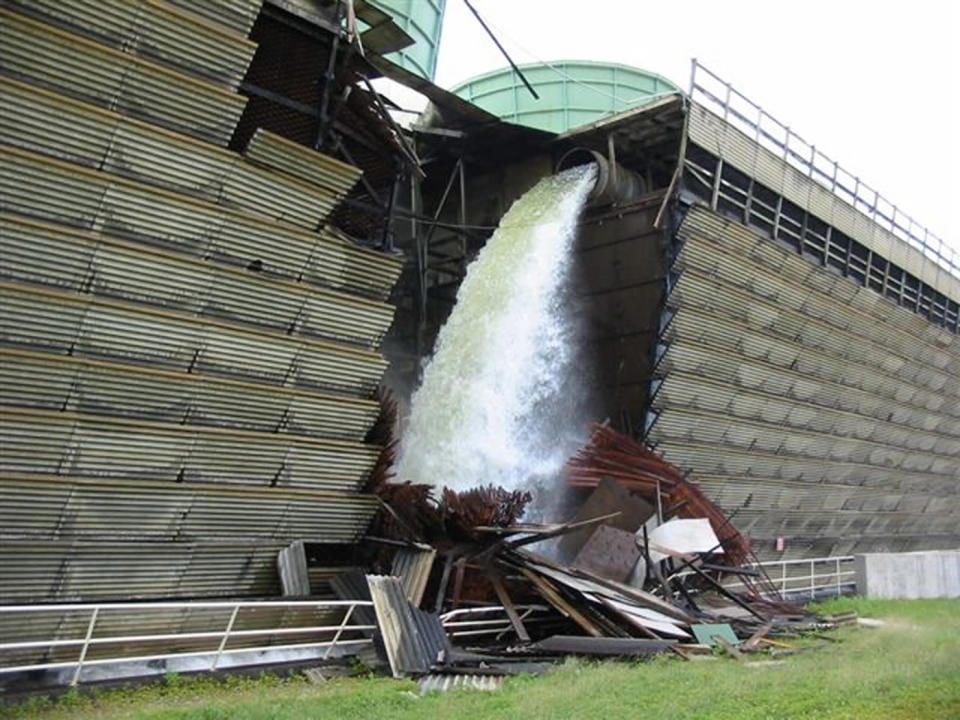 FILE - This undated photo provided by the Nuclear Regulatory Commission shows damage to the cooling tower at the Vermont Yankee power plant in Vernon, Vt. Vermont's only nuclear power plant will shut down by the end of 2014, ending a nasty legal battle over the future of the 4-decade-old plant, Entergy Corp. announced Tuesday, Aug. 27, 2013. The Vermont Yankee Nuclear Power Station is expected to cease power production after its current fuel cycle and will begin being decommissioned in the fourth quarter of 2014, the company said. (AP Photo/U.S. Nuclear Regulatory Commission)
