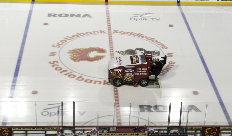 The ice surface is cleaned at an empty Scotiabank Saddledome, home of the NHL's Calgary Flames, on Sunday, Jan. 6, 2013, in Calgary, Alberta. A tentative deal to end the 113-day NHL lockout was reached early Sunday following a marathon 16-hour negotiating session. (AP Photo/The Canadian Press, Larry MacDougal)