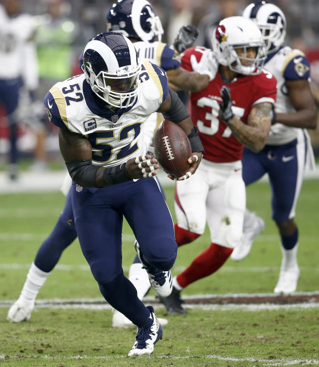 FILE - In this Dec. 3, 2017, file photo, Los Angeles Rams inside linebacker Alec Ogletree (52) returns an interception for a touchdown during the first half of an NFL football game against the Arizona Cardinals in Glendale, Ariz. A person with knowledge of the deal tells The Associated Press on Wednesday, March 7, 2018, that the Rams have agreed to trade linebacker Alec Ogletree to the New York Giants for two draft picks. (AP Photo/Ross D. Franklin, File)