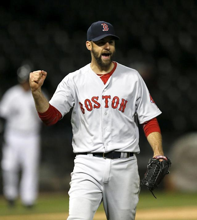 Boston Red Sox relief pitcher Burke Badenhop celebrates the Red Sox's 6-4 win over the Chicago White Sox after the14th inning of a baseball game Thursday, April 17, 2014, in Chicago. (AP Photo/Charles Rex Arbogast)