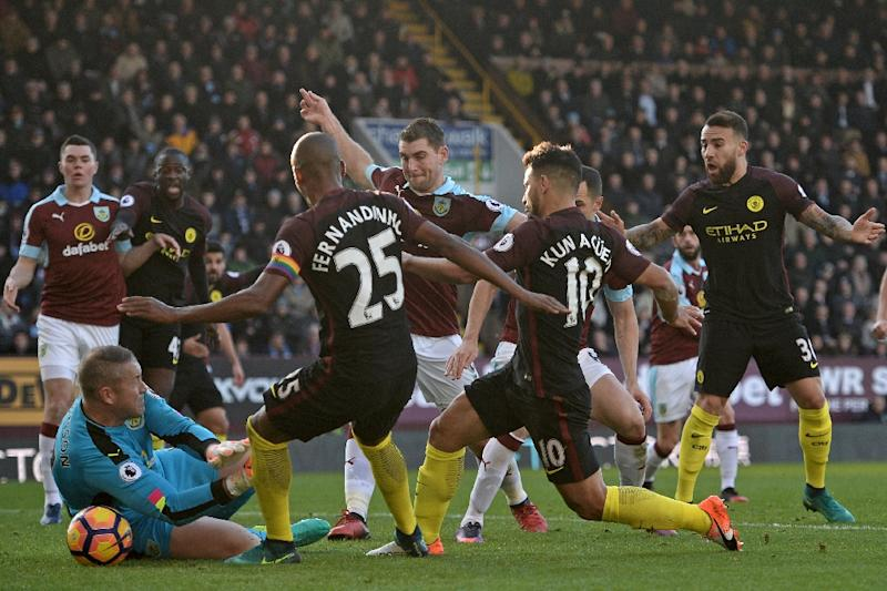 Manchester City's Sergio Aguero (3R) came up with the goals at Burnley that rescued three points for City after they had fallen behind (AFP Photo/Oli Scarff                     )