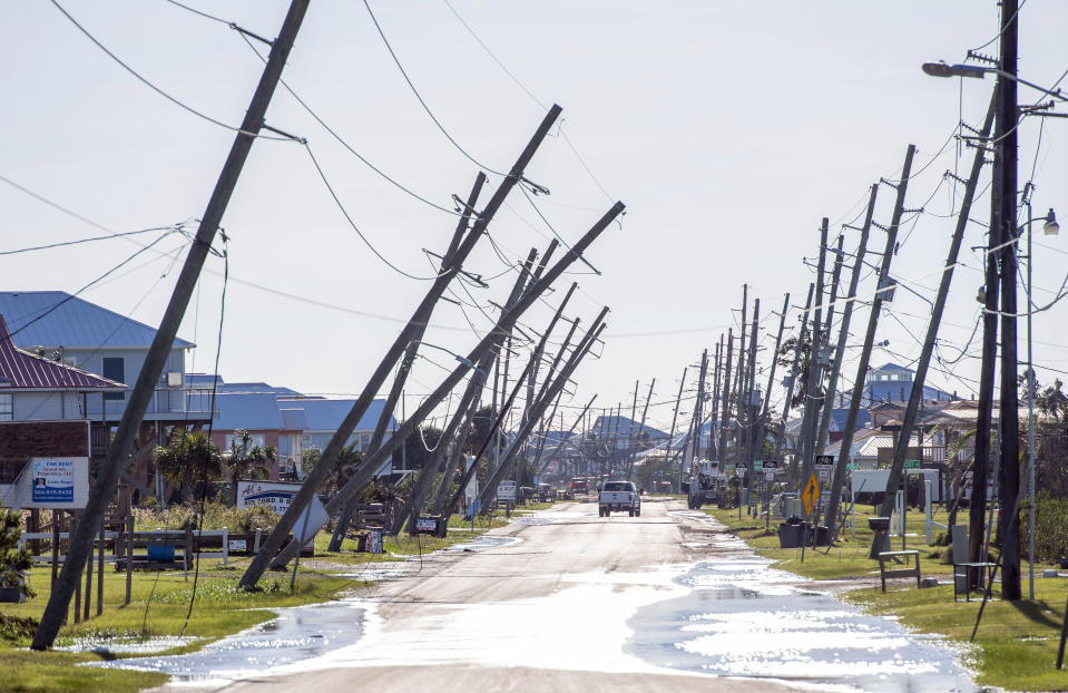 Power poles lean or are broken due to Hurricane Zeta damage Thursday Oct. 29, 2020,, in Grand Isle, La., as part of Gov. John Bel Edwards flyover of stricken areas in the southeastern part of the state. (Bill Feig/The Advocate via AP)