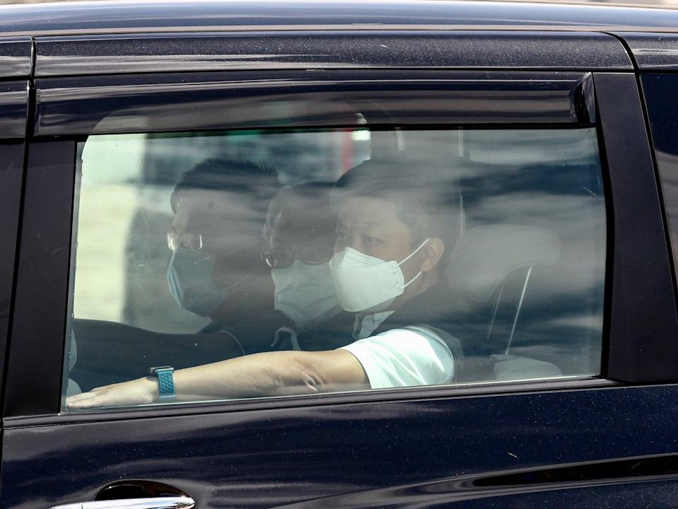 Next Digital CEO Cheung Kim-hung sits flanked by police inside a vehicle after being detained on Thursday. Photo: Sam Tsang
