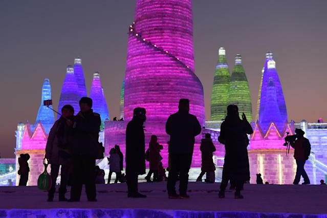 <p>People visit the Harbin Ice and Snow World, part of the annual Harbin Ice and Snow Sculpture Festival in China's northeast Heilongjiang province. (Photo: Greg Baker/AFP/Getty Images) </p>