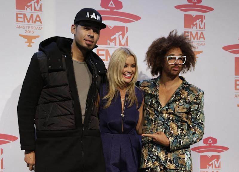 DJ Afrojack, presenter Laura Whitmore and musician Redfoo pose for photographers at the press conference for the European MTV Awards 2013 in Amsterdam, Saturday, Nov. 9, 2013. (AP Photo/Peter Dejong)