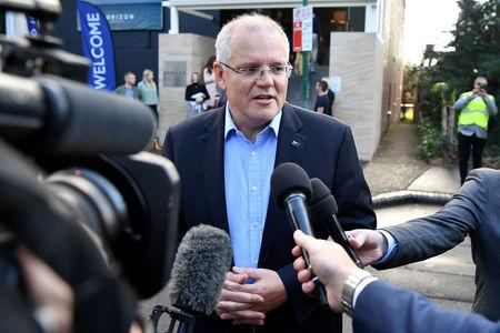 FILE PHOTO: Australian Prime Minister Morrison speaks to the media as he arrives at the Horizon Church in Sutherland