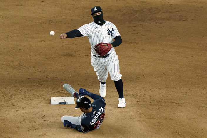 New York Yankees second baseman Rougned Odor throws to first after forcing out Atlanta Braves' Ehire Adrianza on a ball hit by Marcell Ozuna, who was safe during the ninth inning of a baseball game Wednesday, April 21, 2021, at Yankee Stadium in New York. The Braves won 4-1. (AP Photo/Kathy Willens)