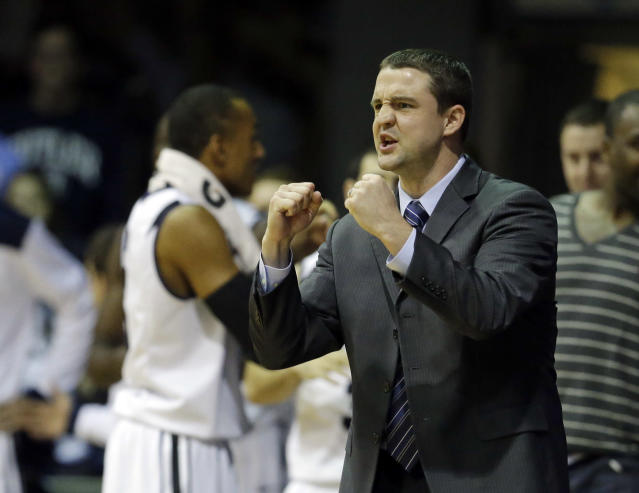 Butler head coach Brandon Miller encourages his team during the first half of an NCAA college basketball game against Vanderbilt Tuesday, Nov. 19, 2013, in Indianapolis. (AP Photo/Darron Cummings)