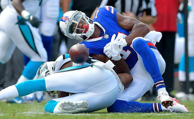 <p>James Bradberry #24 of the Carolina Panthers separates Zay Jones #11 of the Buffalo Bills from the ball during their game at Bank of America Stadium on September 17, 2017 in Charlotte, North Carolina. (Photo by Grant Halverson/Getty Images) </p>
