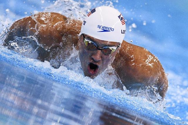(FILES) This file photo taken on August 10, 2016 shows USA's Ryan Lochte as he competes in a Men's 200m Individual Medley heat during the swimming event at the Rio 2016 Olympic Games at the Olympic Aquatics Stadium in Rio de Janeiro. Six-time Olympic gold medalist Ryan Lochte said on July 14, 2017 he's not quite ready to plunge back into competition in the wake of his 10-month ban after family duties disrupted his recent training, website Floswimming.com reported.Lochte, who was banned by USA Swimming over his bogus gunpoint robbery story that embarrassed Rio Olympics organizers last year, welcomed the birth of son Caiden with fiancee Kayla Rae Reid last month. (AFP Photo/Martin BUREAU)