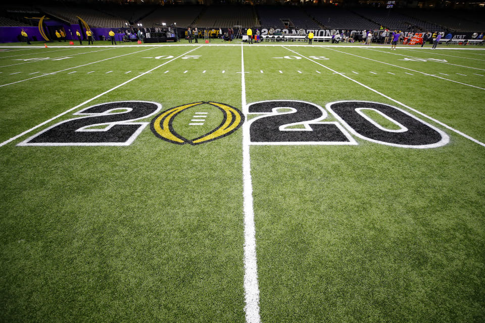 The CFB 2020 logo is displayed on the field prior to the College Football Playoff title game between LSU and Clemson on Jan. 13, 2020. (Todd Kirkland/Icon Sportswire/Getty Images)
