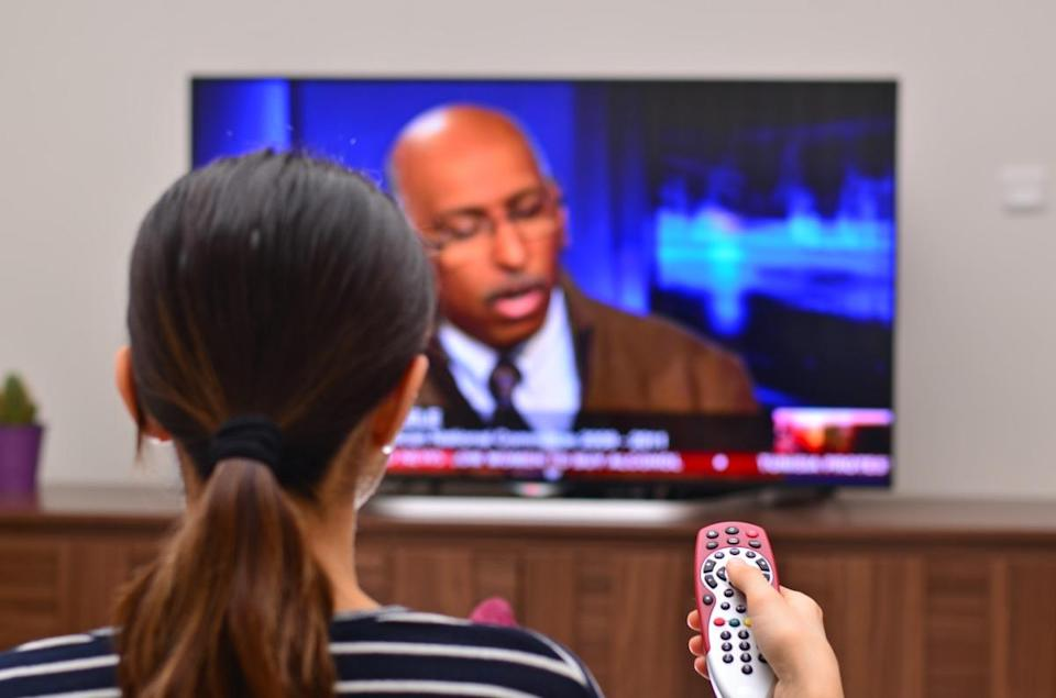 Women is watching news on a global tv channel