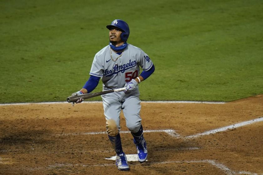 The Dodgers' Mookie Betts watches his foul ball during the seventh inning against the Angels on Aug. 14, 2020.