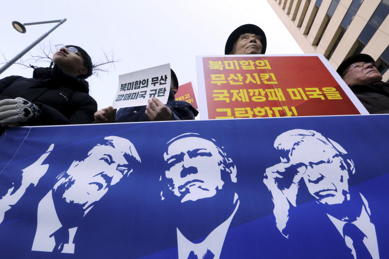 "Protesters hold a banner showing images, from left, of U.S. President Donald Trump, Secretary of State Mike Pompeo and National Security Adviser John Bolton during a rally against the United States' policy to put steady pressure on North Korea, near the U.S. Embassy in Seoul, South Korea, Friday, March 22, 2019. The Trump administration on Thursday sanctioned two Chinese shipping companies suspected of helping North Korea evade sanctions, the first targeted actions taken against Pyongyang since its nuclear negotiations with the U.S. in Hanoi last month ended without agreement. The signs read: ""We denounce the United States."" (AP Photo/Ahn Young-joon)"