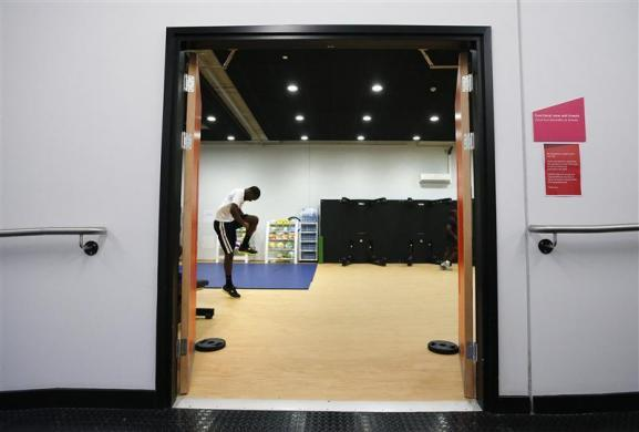 hane Brathwaite, a member of the Barbados athletics team, works out at the athletes village at the Olympic Park in London July 20, 2012.