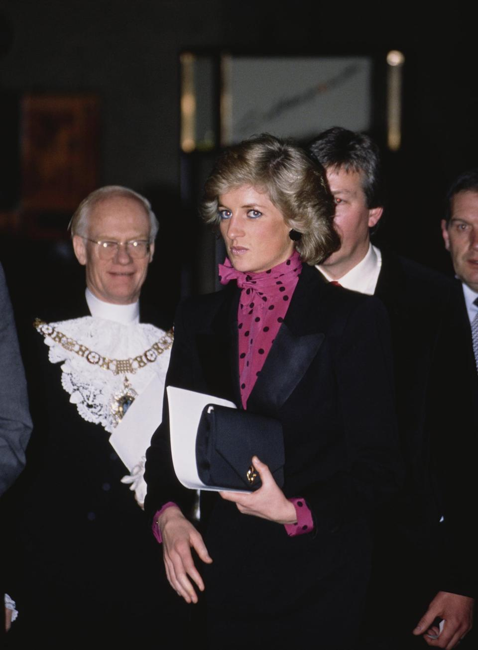 <p>Diana also owned this square design with an envelope flap, which she carried to a concert in 1988 while wearing a polka-dot pussy-bow blouse.</p>