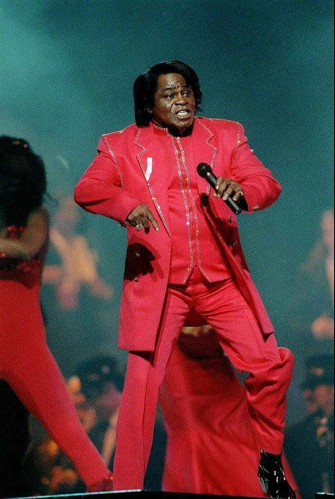 """<p>Brown wore a red bedazzled suit.</p><p><a class=""""link rapid-noclick-resp"""" href=""""https://www.youtube.com/watch?v=nC_iiq06qck&ab_channel=ryokanam"""" rel=""""nofollow noopener"""" target=""""_blank"""" data-ylk=""""slk:WATCH NOW"""">WATCH NOW</a></p>"""