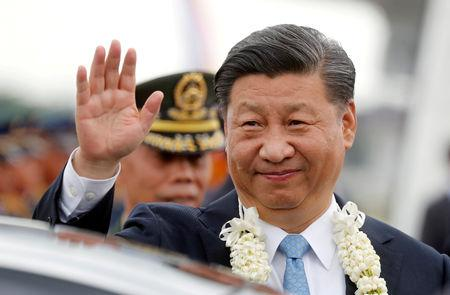 FILE PHOTO: China's President Xi Jinping waves to the crowd upon his arrival at Ninoy Aquino International airport during a state visit in Manila